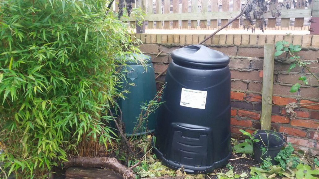 compost bins in a tiny garden