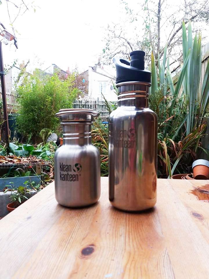 Reausable bottles in the less stuff garden